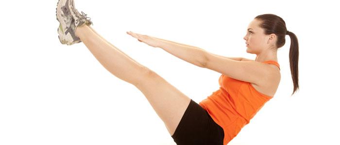 Woman doing jack knife ab exercise