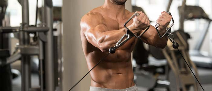 Man performing cable pec fly