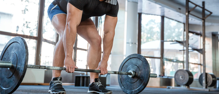 person about to do a deadlift with a barbell