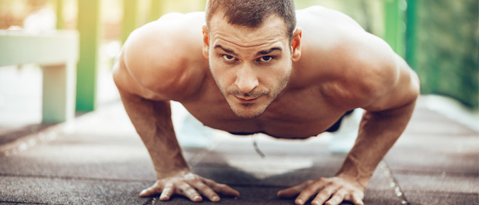 a person performing a parallel push up