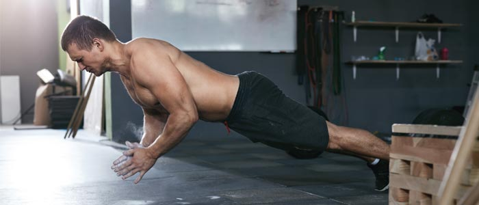 person performing a clap push up