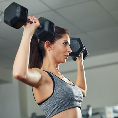 Woman shoulder pressing