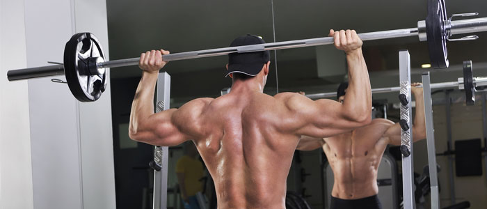 person performing a behind-the-neck shoulder press