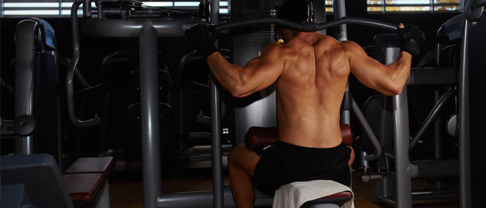 person performing a behind-the-neck lat pulldown