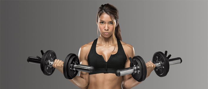 person holding two dumbbells