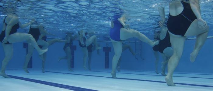 People exercising underwater