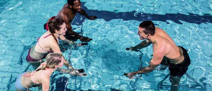 Group using exercise bikes underwater