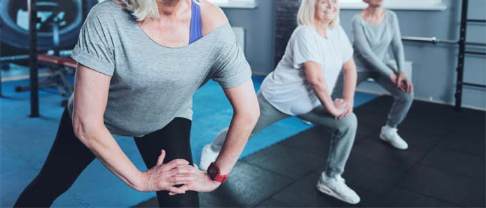 a class of older people stretching