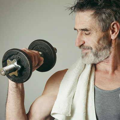 an older person lifting a dumbbell