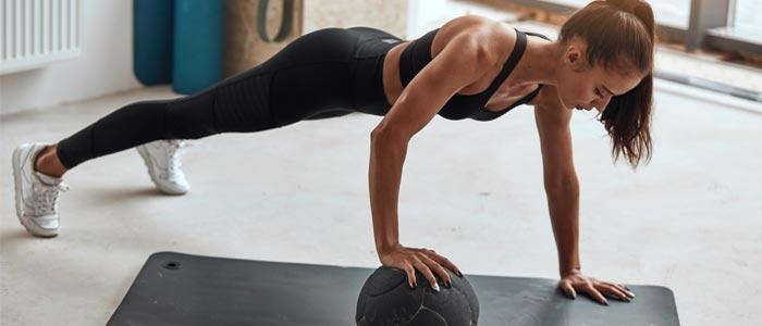 Woman balancing on a medicine ball