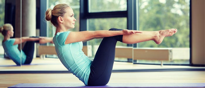 Person concentrating during pilates