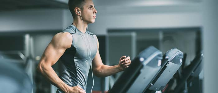 person running on treadmill in gym