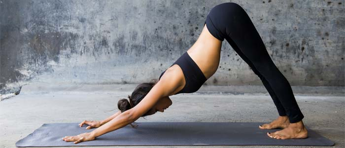 person performing a downward dog