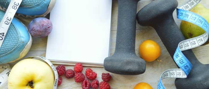 fruit, dumbbells, tape