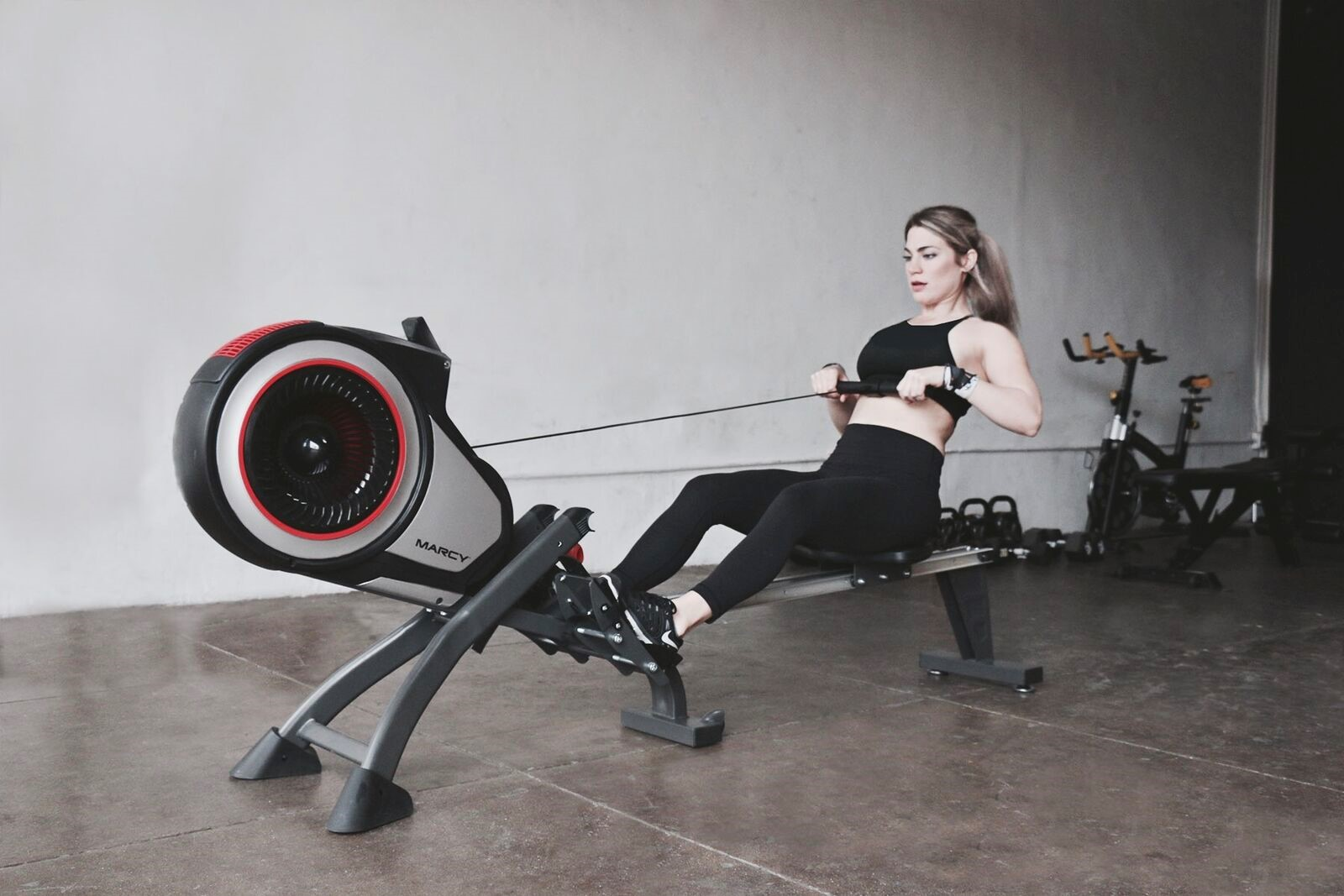 person on the rowing machine