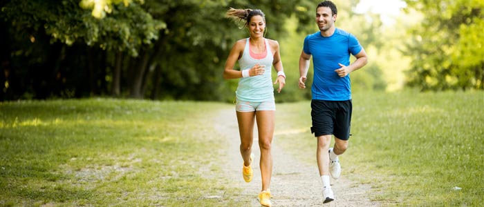 two people running together down a country path