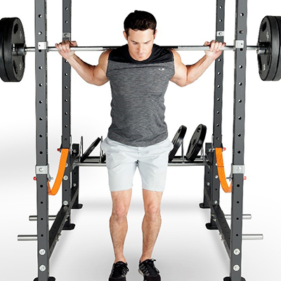 person squatting in a power rack