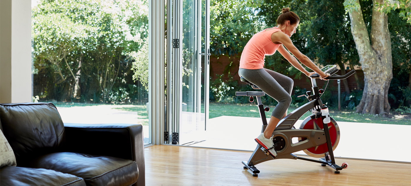 person cycling on exercise bike