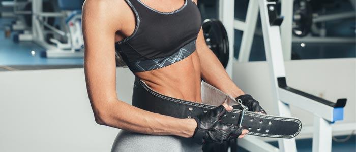 a person doing up a weight belt