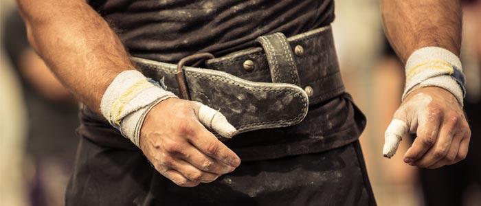 a person wearing a battered weight belt
