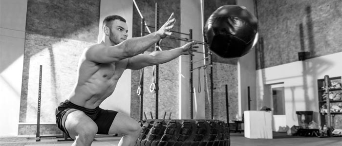 person throwing a medicine ball out in front of them