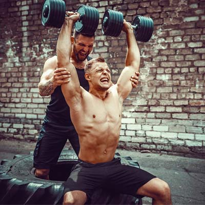 person doing assisted Arnold press