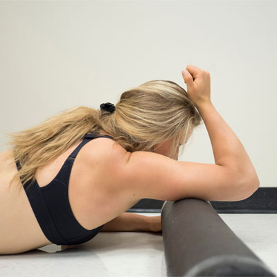 woman rolling triceps