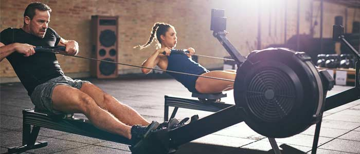 People using rowing machines training for fitness results