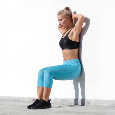 Woman performing wall sits