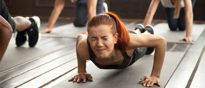 Woman struggling to do a push up