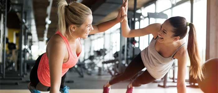 Women high fiving during pushup
