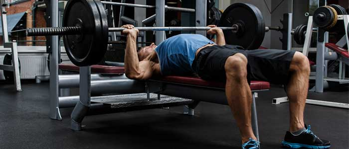 person bench pressing