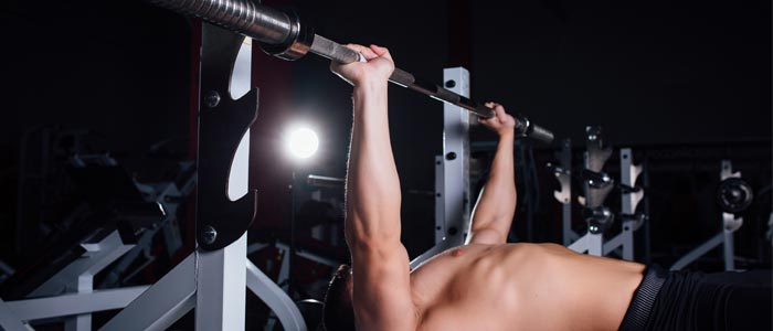 Person bench pressing a barbell