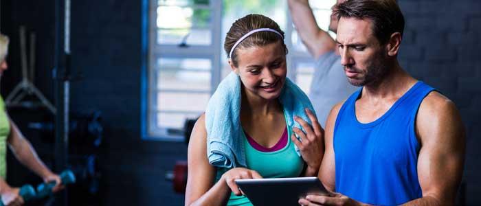 Man and woman tracking workout progress
