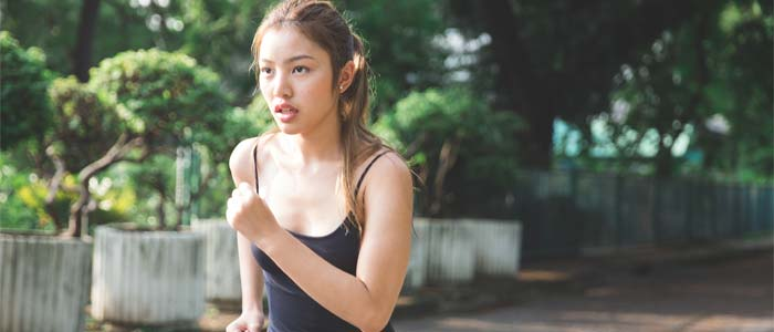 Determined woman jogging