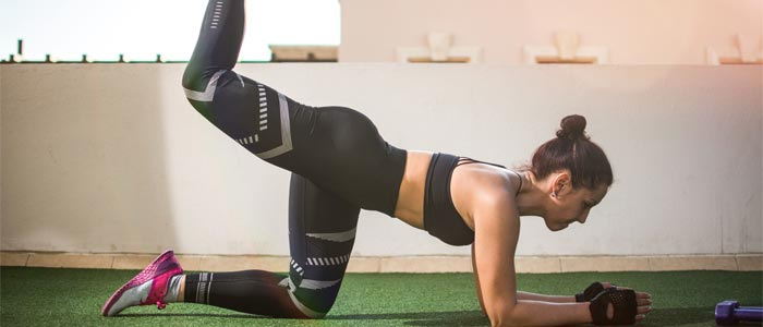 Woman performing leg kickbacks