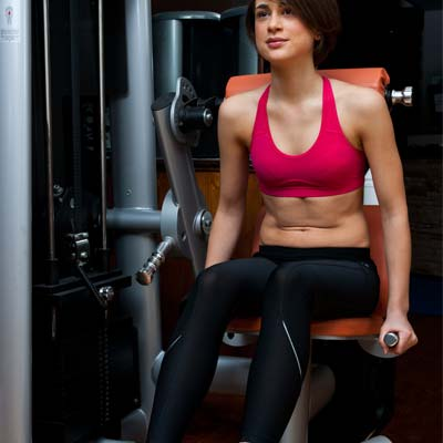 Woman exercising on lower back machine