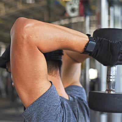 Man performing tricep extensions