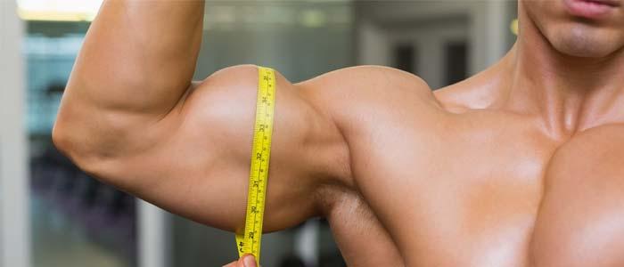 Man measuring his bicep size