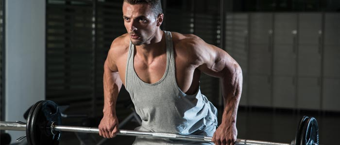 Man concentrating while performing the bent row