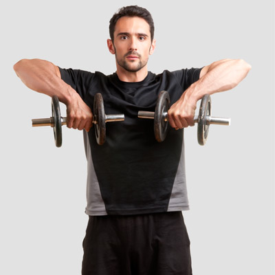 Man performing the upright row with dumbbells