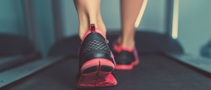 Close up of running shoes on a treadmill