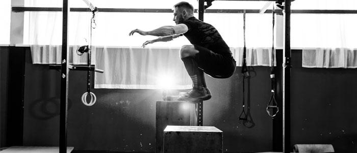 Man performing box jumps