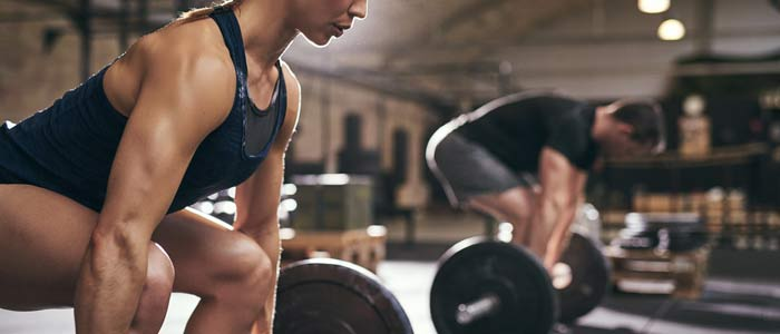 close-up of people lifting weights