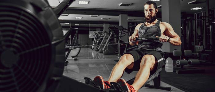 man exercising on a rowing machine