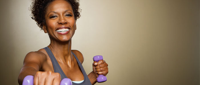 Woman using small dumbbells