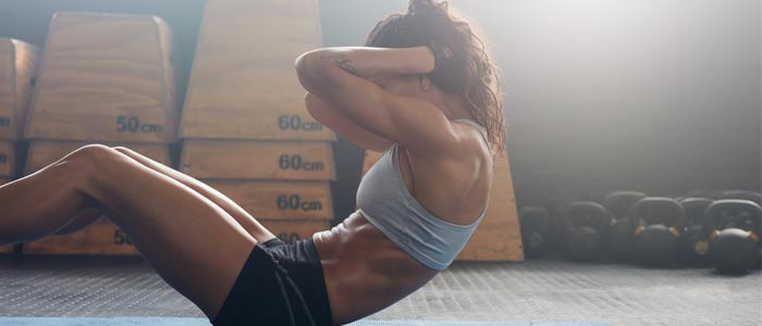 Woman training her abs