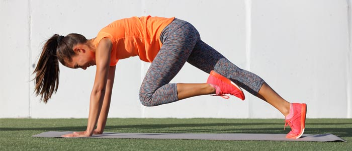 Person performing mountain climbers