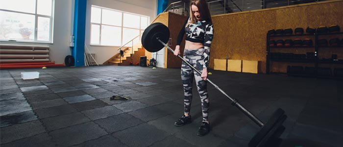 Woman dropping a barbell