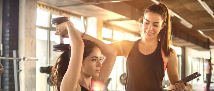 Women coaching in a gym